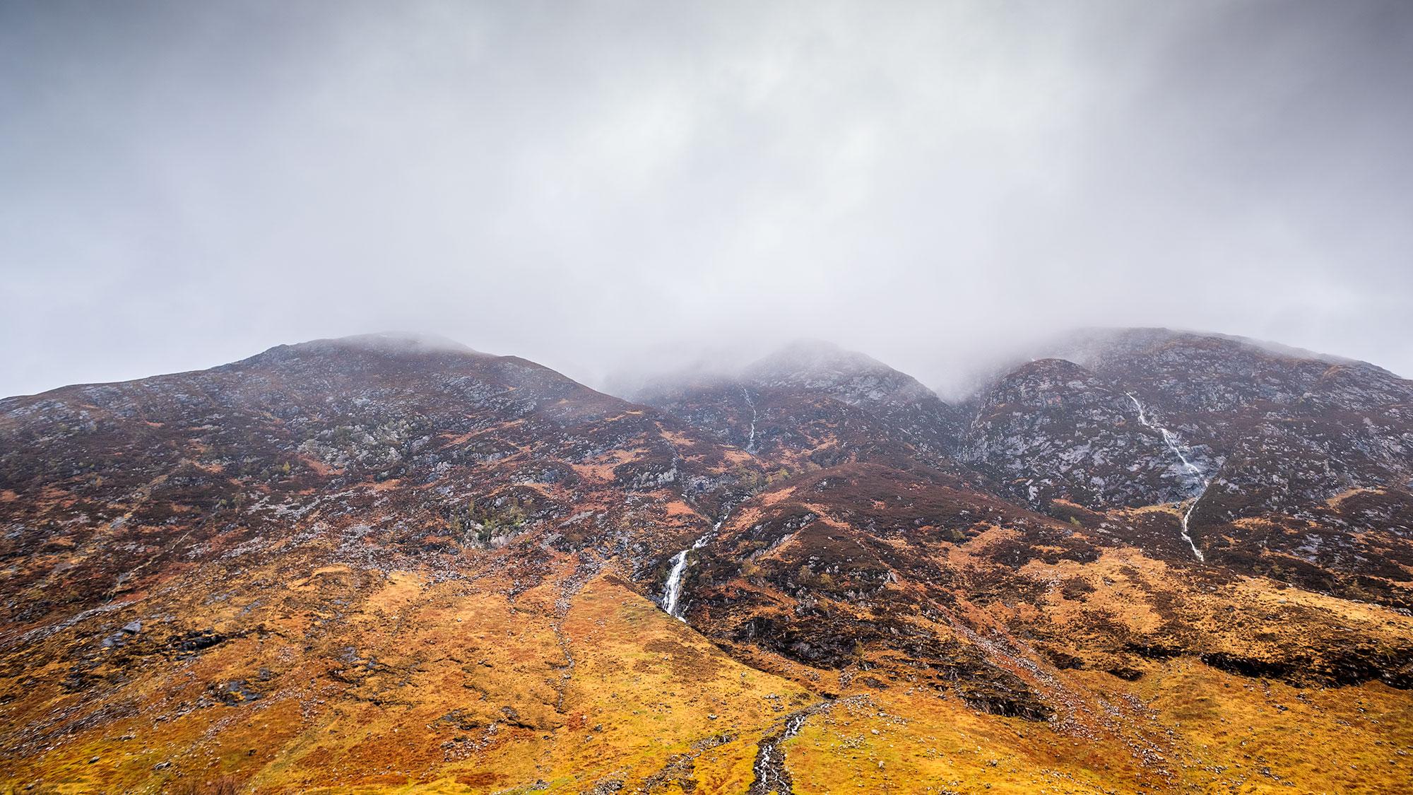 Dramatic and moody landscape photography taken on Skye Island by the photographer Jennifer Esseiva.