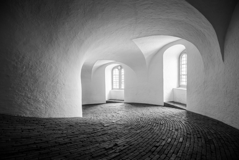 Black and white photography of the Rundetaarn in Copenhagen taken by travel photographer Jennifer Esseiva.