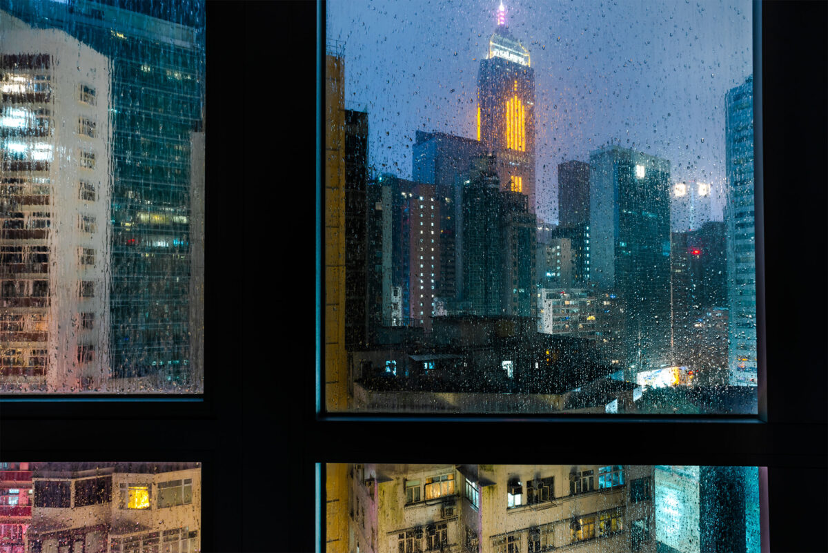 Night photography of Hong Kong from a 24th floor appartement taken by travel photographer Jennifer Esseiva.