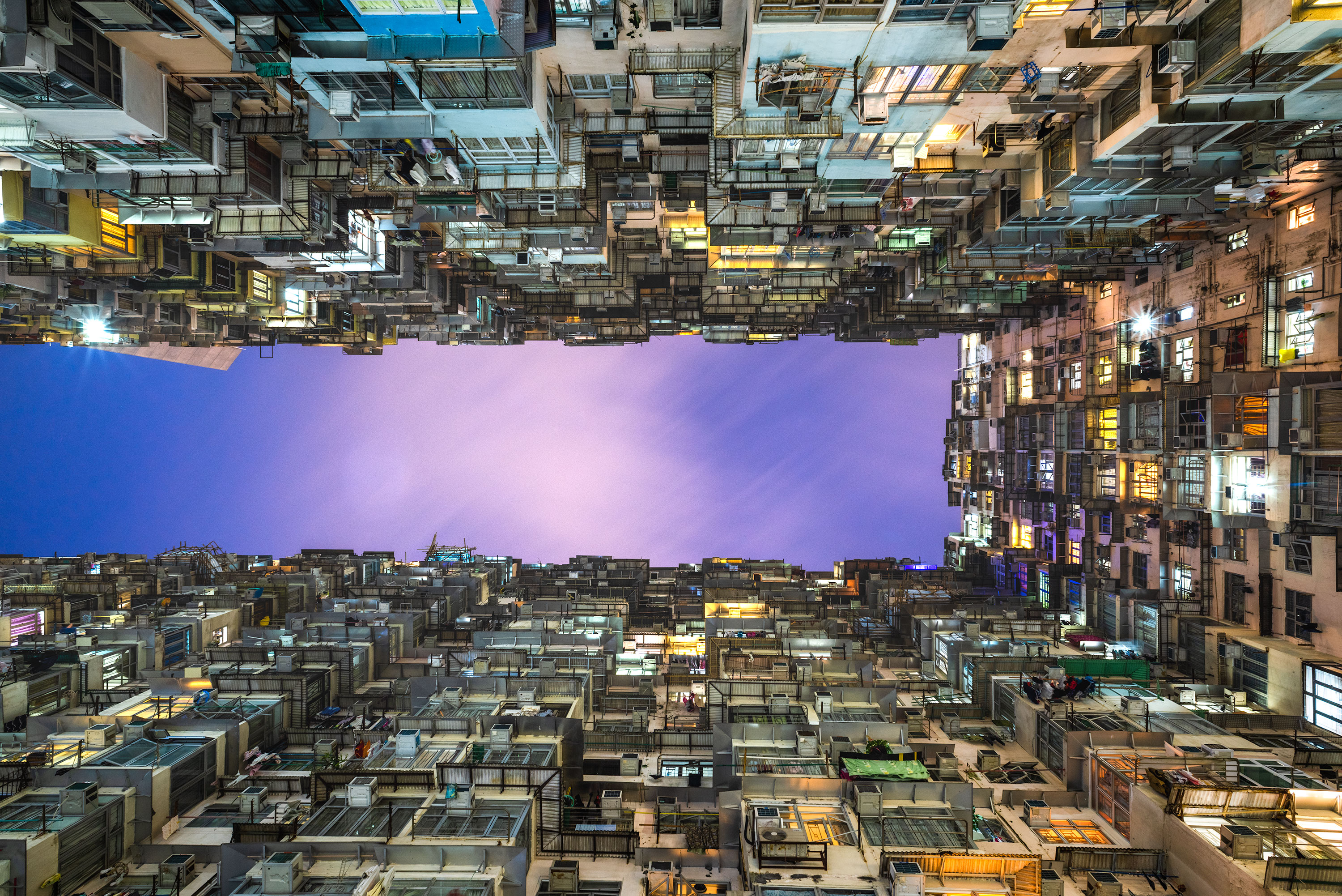 Night photography of the monster building in Hong Kong taken by Jennifer Esseiva.