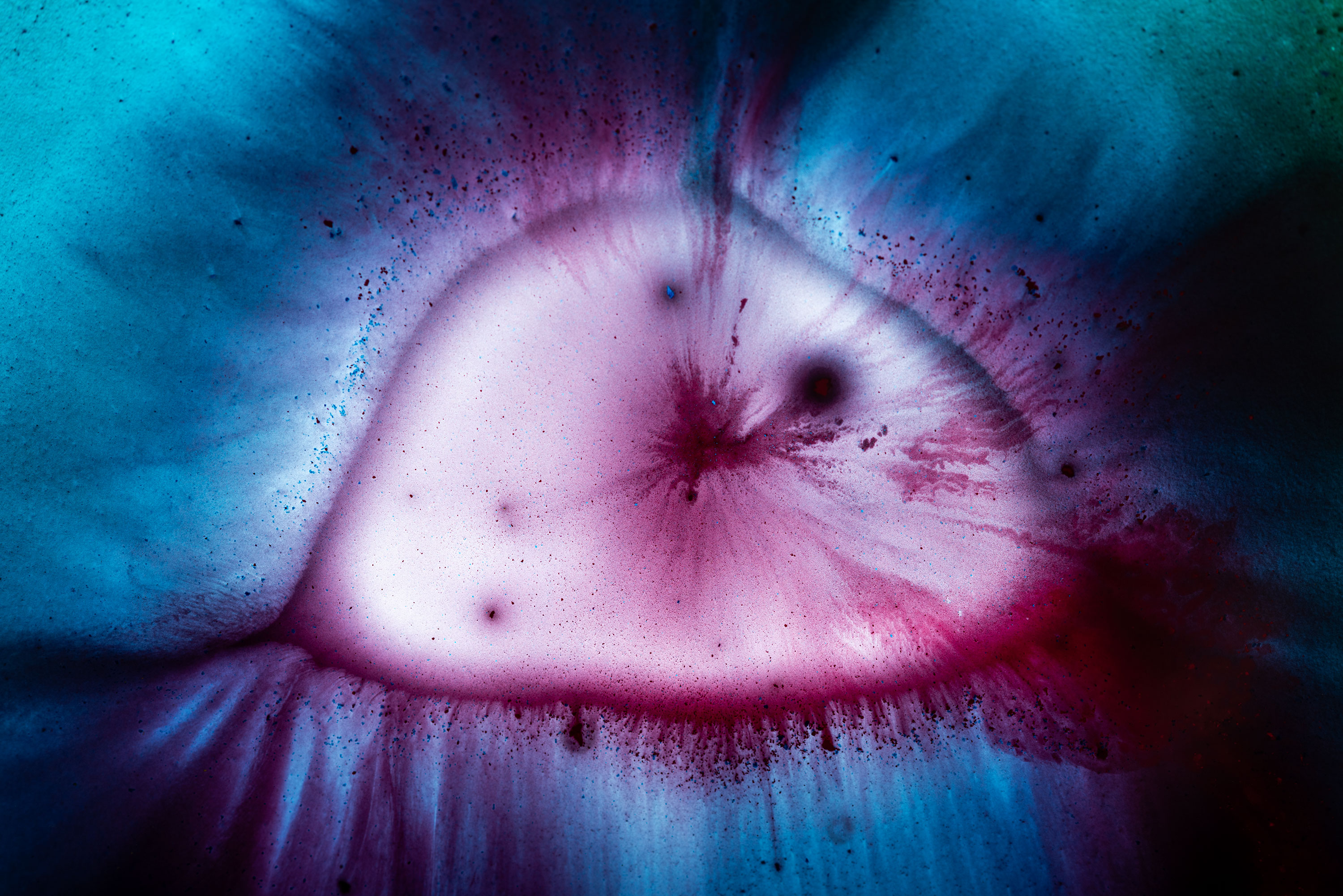 Cyan and magenta watercolor close-up photography creating a landscape looking like an island ©Jennifer Esseiva