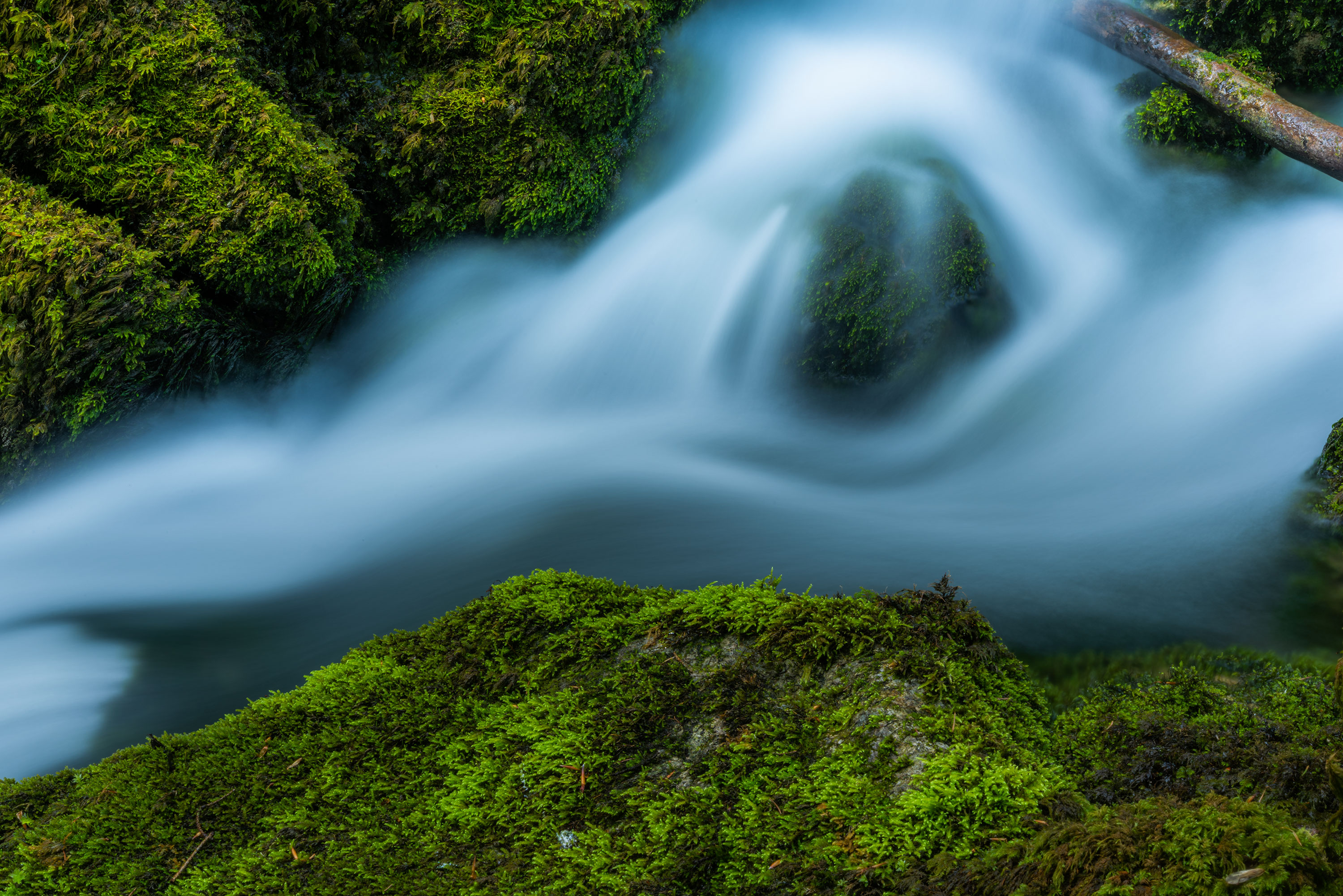 Close up of river and long exposure photography, in Switzerland. Image by Jennifer Esseiva.