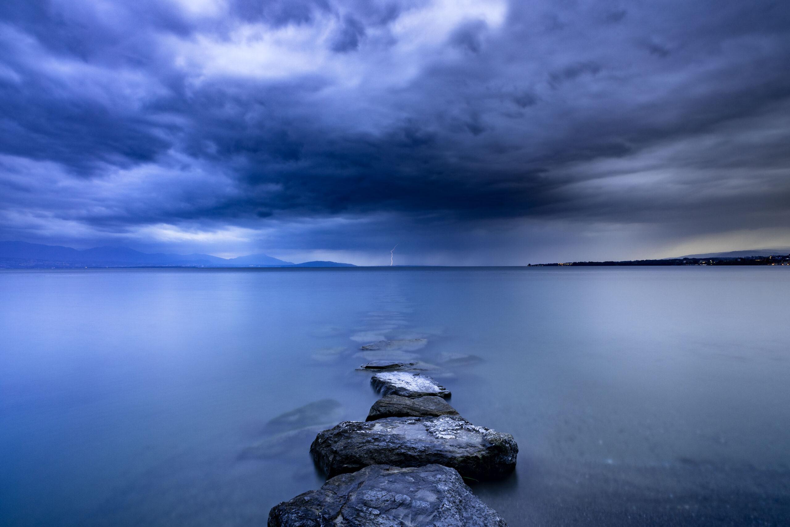 Landscape photography of a thunder storm over the Lake Geneva. Image by Jennifer Esseiva.