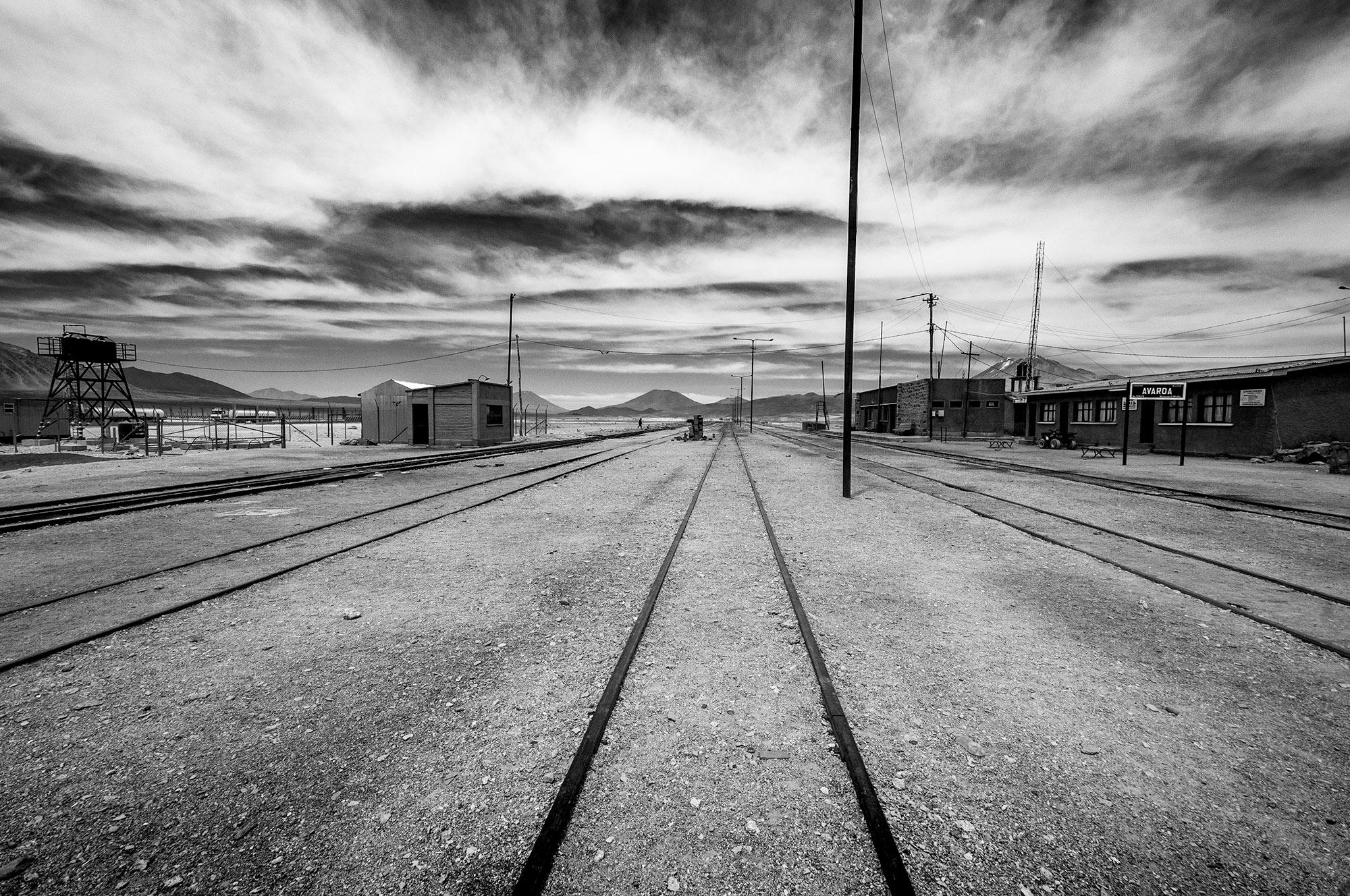 Black and white photography of a railway going to the Bolivian Altiplano. Image by Jennifer Esseiva.