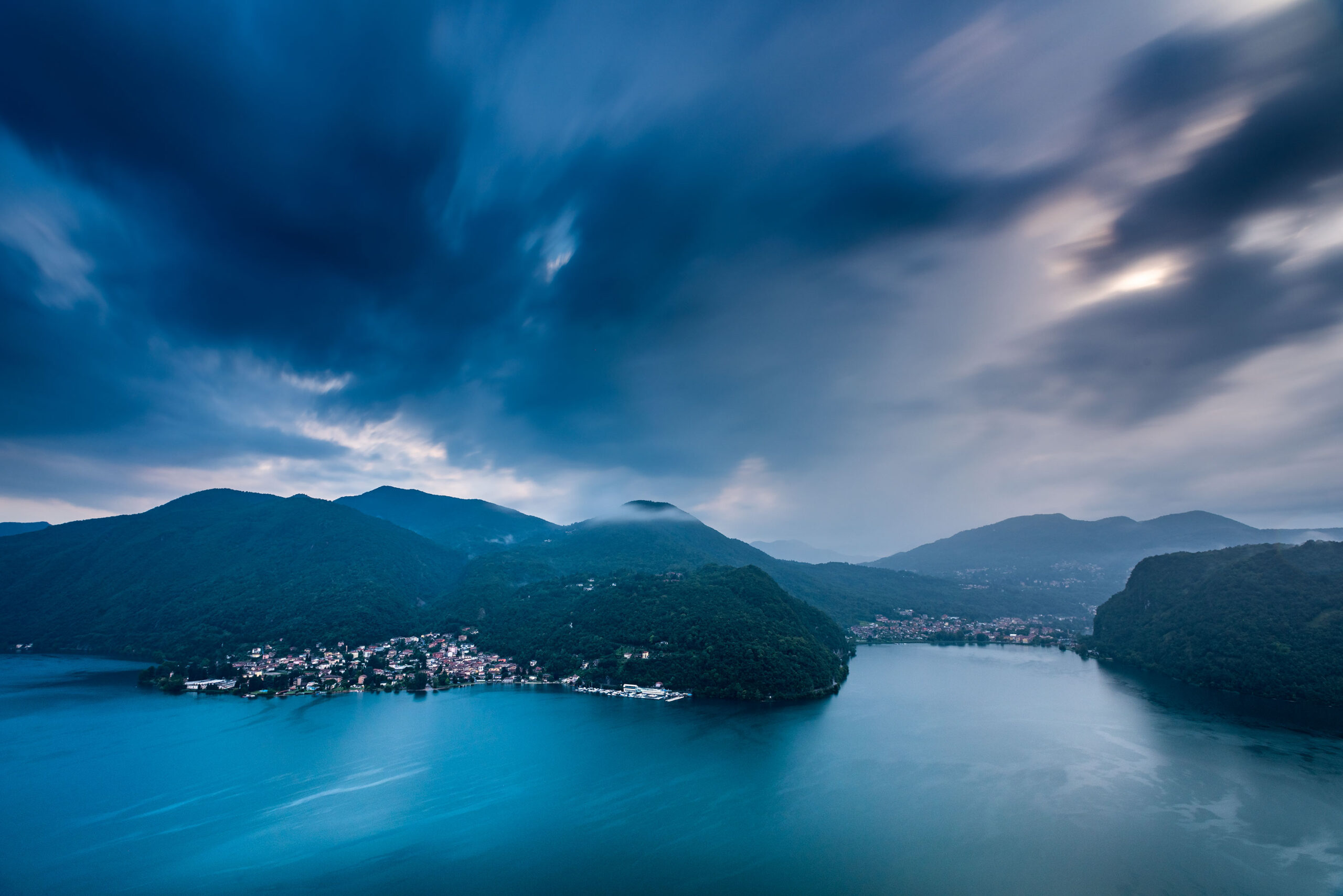 Blue hour photography of Lake Lugano from the Collina d'Oro located near Lugano in Switzerland. Image by Jennifer Esseiva.