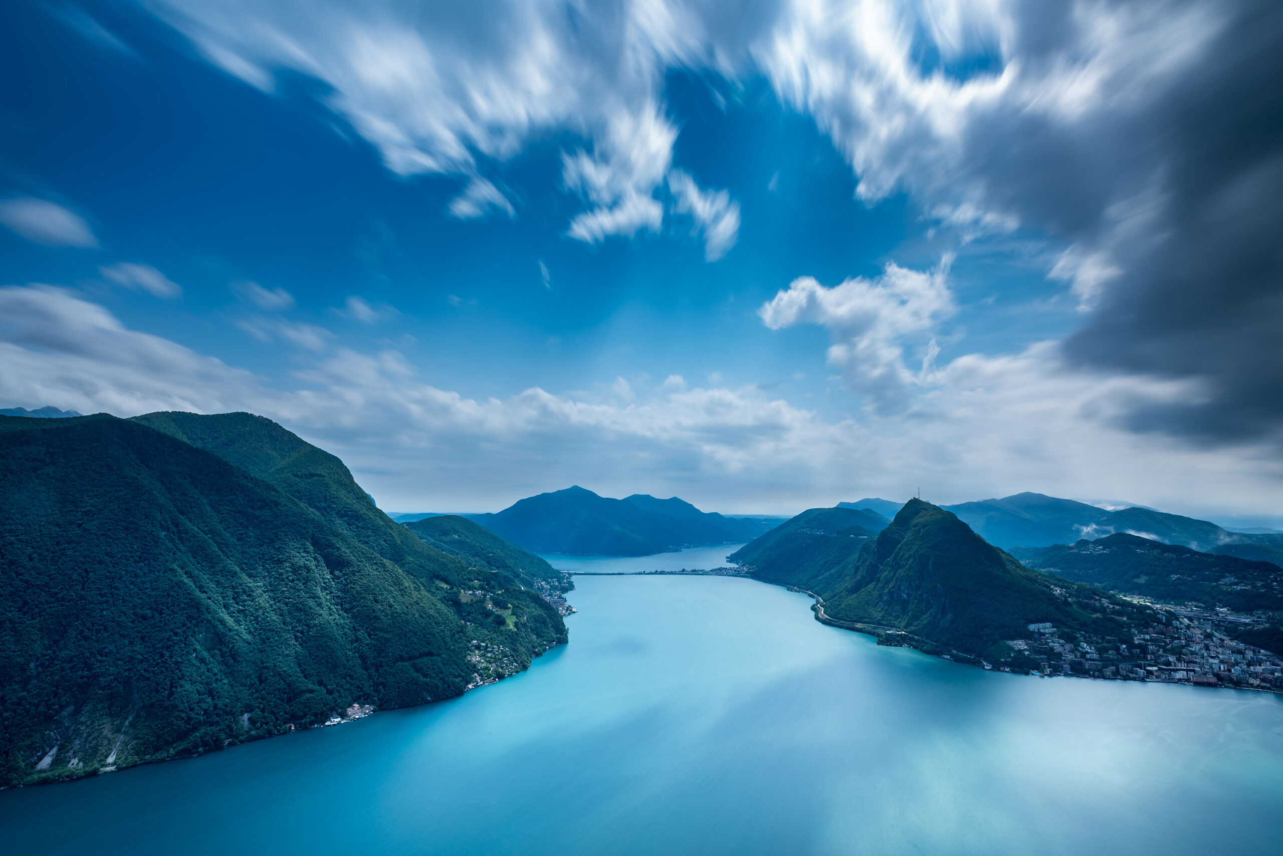 Long exposure photography of Lake Lugano from Monte Brè in Ticino, Switzerland.
