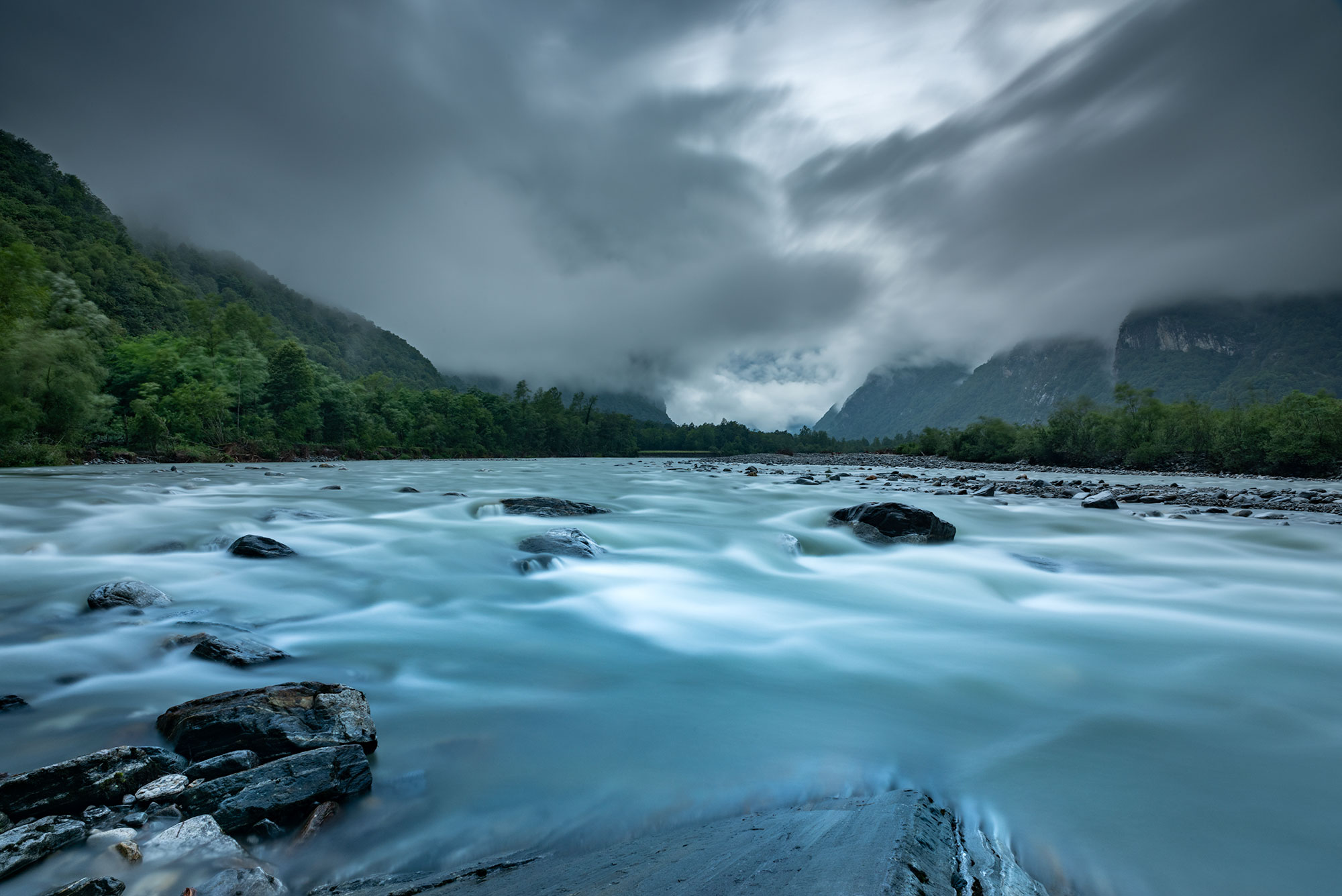 Fine art and long exposure photography of the Maggia River in Ticino, Switzerland. Image by Jennifer Esseiva.