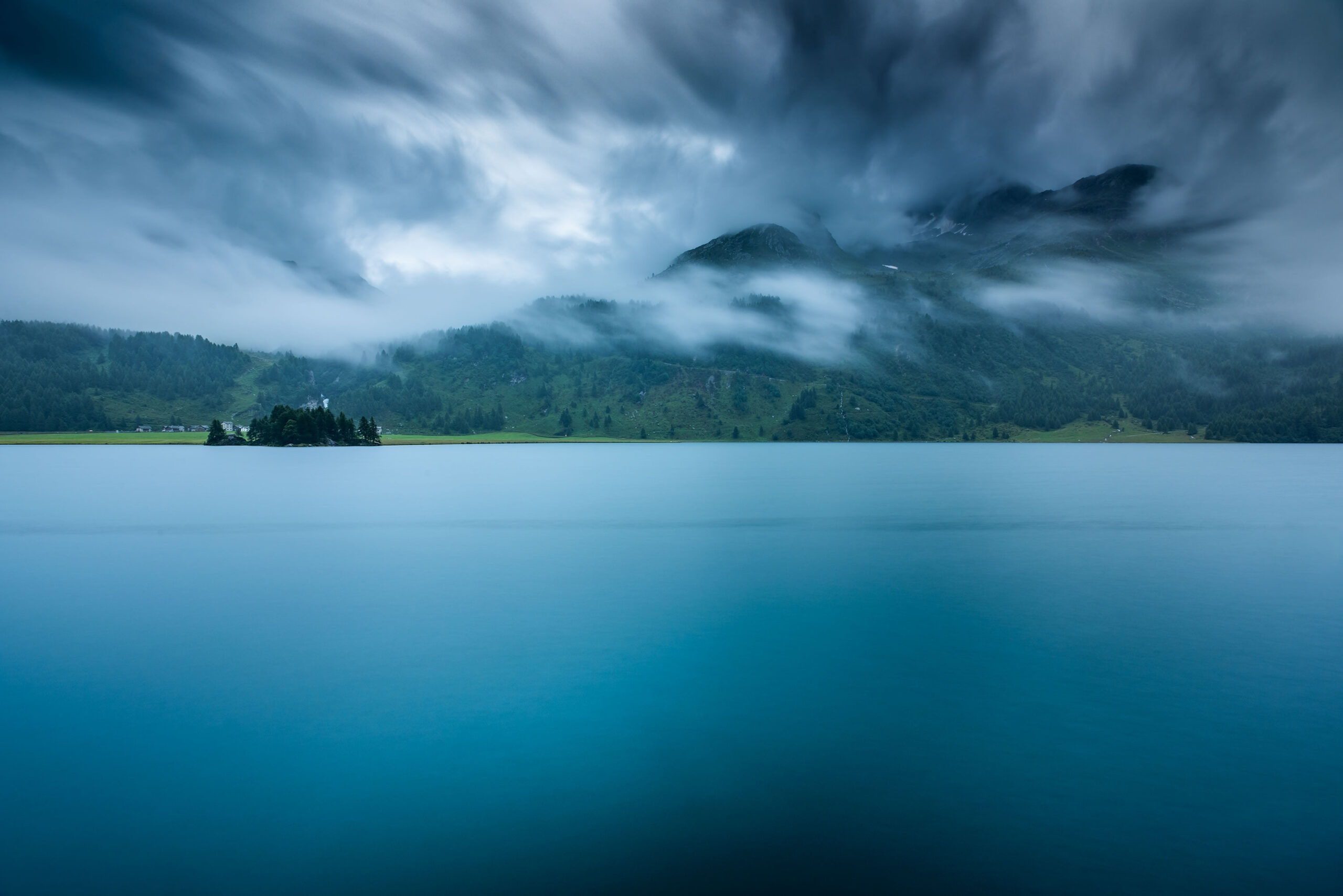 Landscape photography of the Lake Sils located in St. Moritz in Graubünden, Switzerland. Image by Jennifer Esseiva.