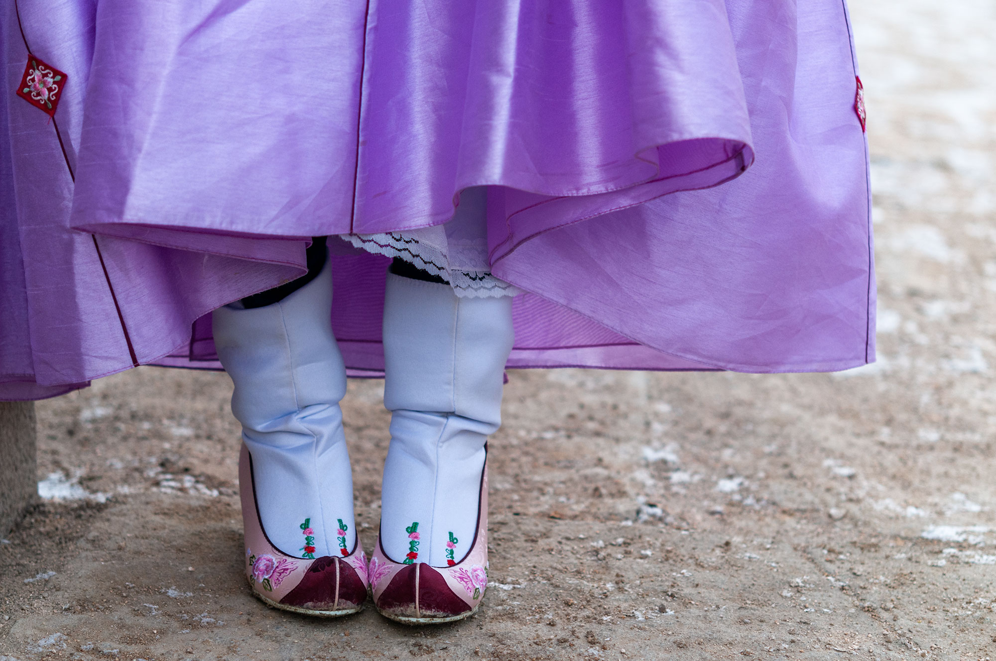 Photography of the hanbok shoes worn by a korean girl in  Changgyeonggung Palace in South Korea.