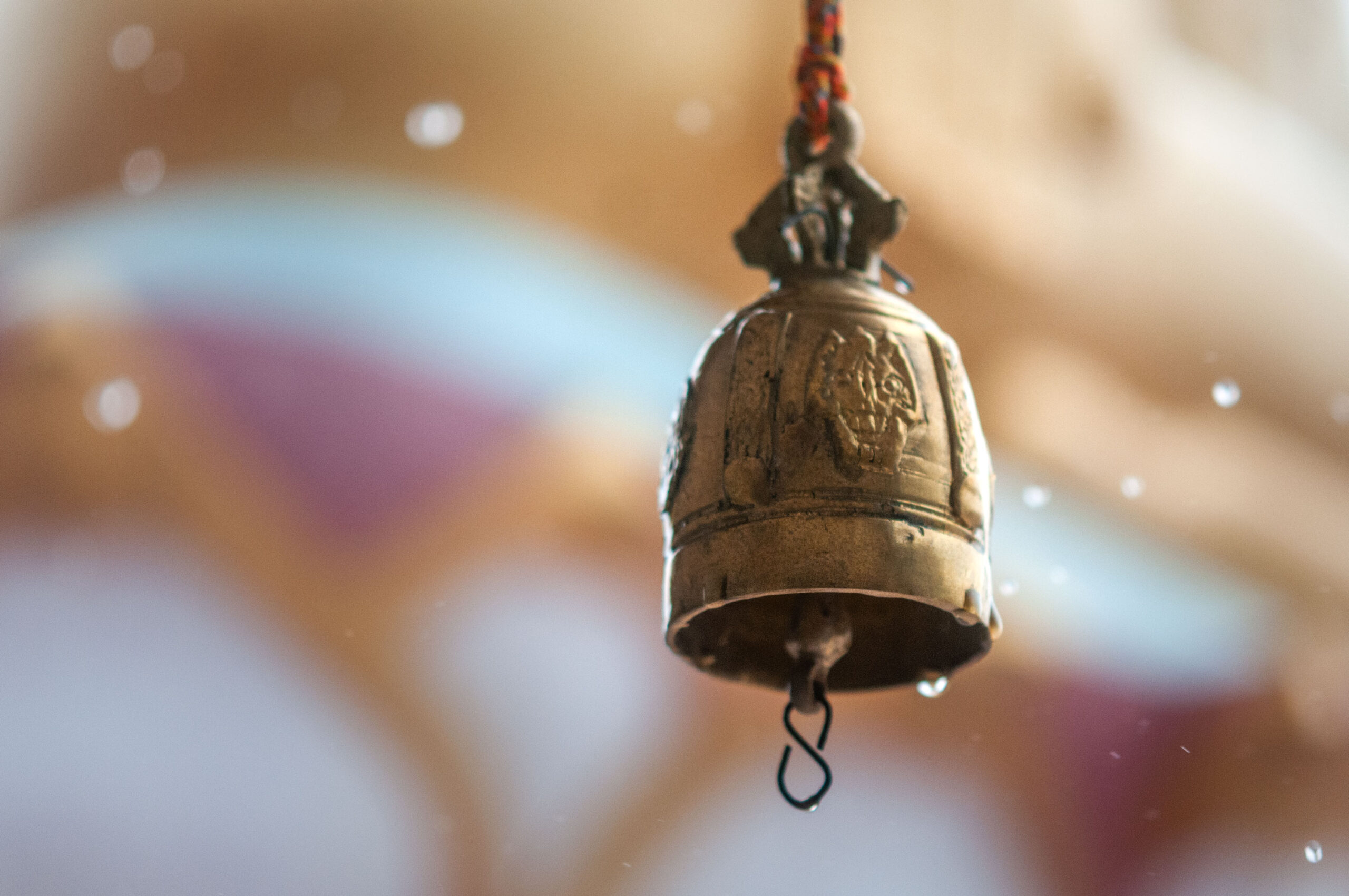 Close-up photography of a temple bell under the rain in Koh Samui, Thailand.