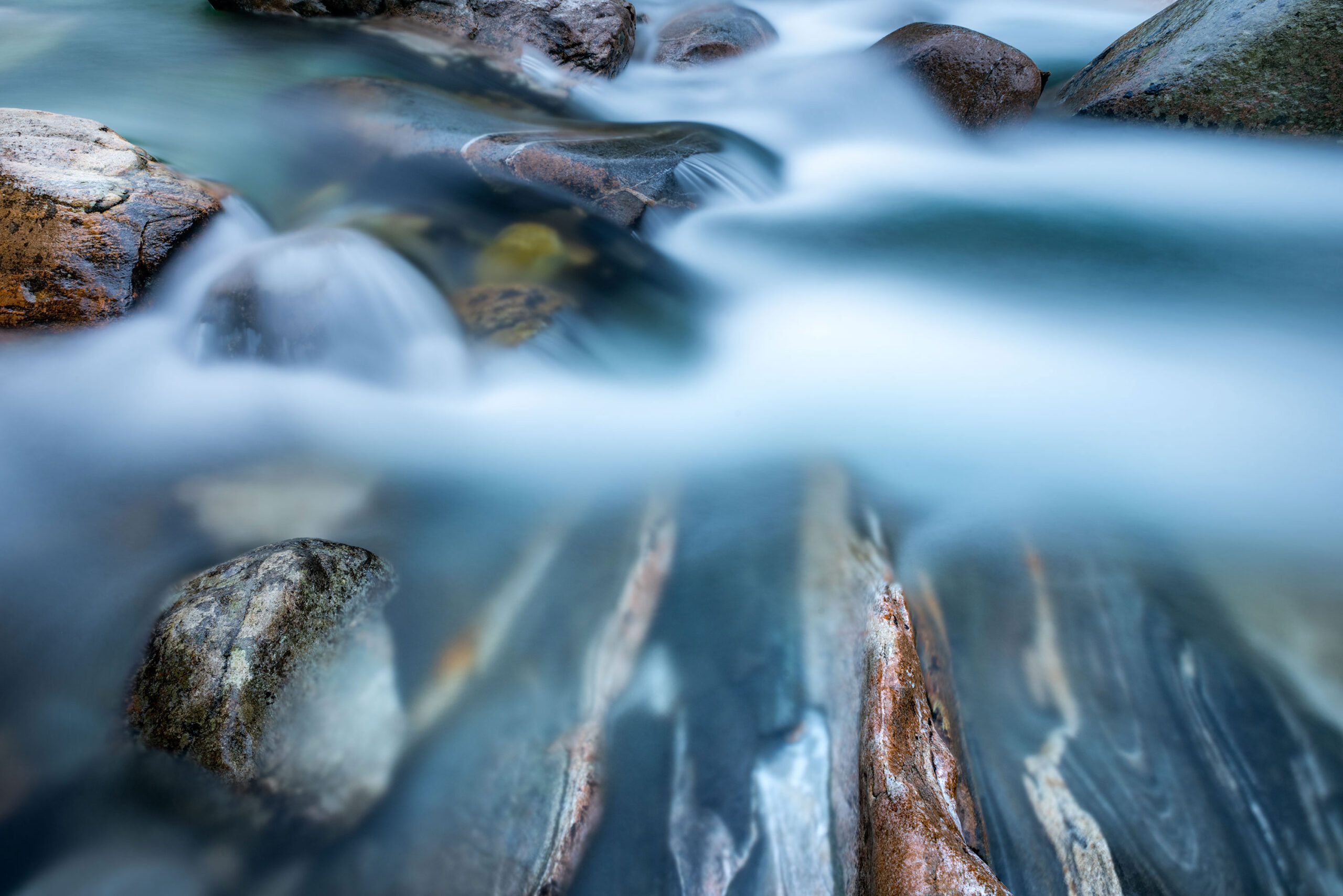 Close up fine art and long exposure photography of the Verzasca River in Ticino, Switzerland. Image by Jennifer Esseiva.
