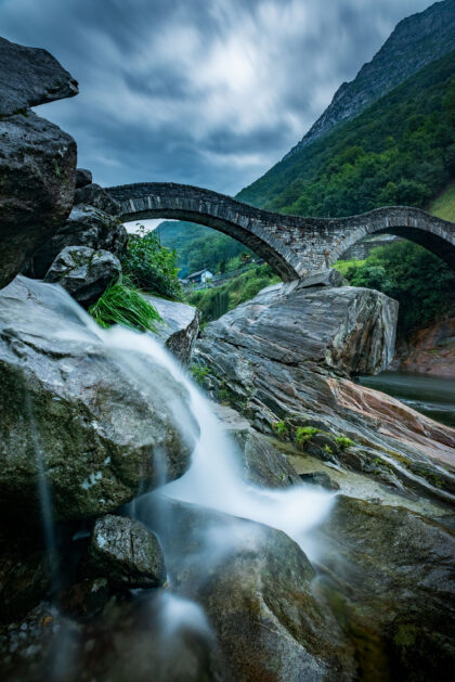 Fine art and long exposure photography of the Ponte dei Salti in Valle Verzasca in Ticino, Switzerland.